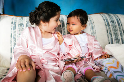 Cute flower girls in pink dressing gowns Los Angeles