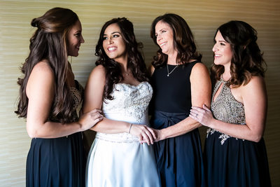 Bride with mom and sisters in Anaheim Hills suite