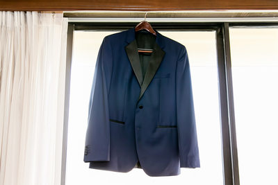 Groom's suit jacket hanging in Sacramento hotel suite