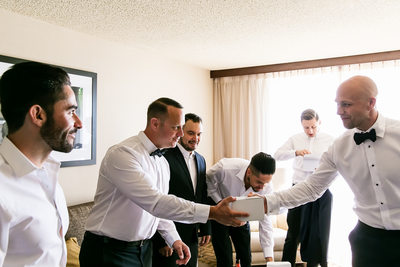 Groom giving groomsmen gifts at Sacramento wedding