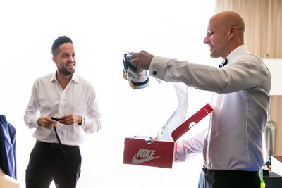 Groom opening gift of Nike shoes at Sacramento wedding