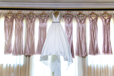 Bride and bridesmaids dresses hanging Sacramento hotel