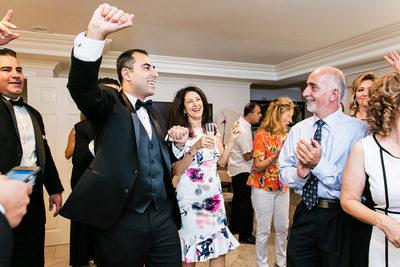 Groom dancing at Armenian wedding preparations