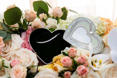 Bride's necklace in heart box at Los Angeles wedding