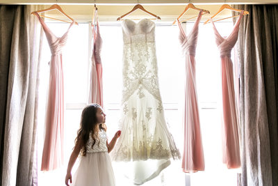 Flower girl admiring wedding dresses in Glendale