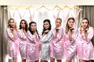 Bridesmaids in pink blowing kisses in Los Angeles