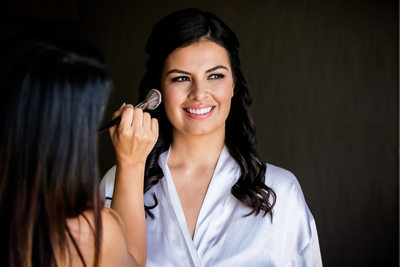 Bride having makeup applied by Glendale photographer