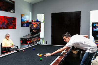 Groom playing pool with dad in Los Angeles games room