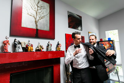Groom and best man getting ready in private games room