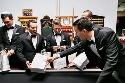 Groomsman reacts to gift from groom at LA wedding