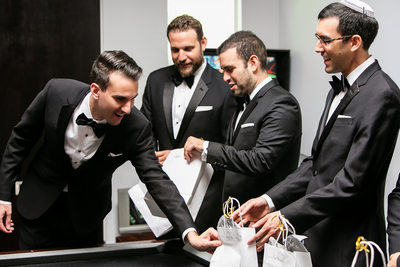 Groom giving groomsmen gifts on wedding day in LA
