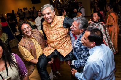 Father lifted into air at Indian Sangeet ceremony