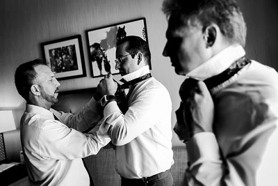 Black and white groomsmen getting ready photo