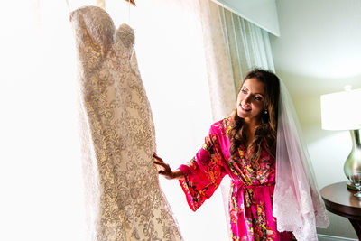 Bride admires wedding dress at Fess Parker Resort