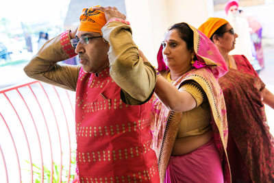 Parents getting ready for Sikh Indian wedding ceremony