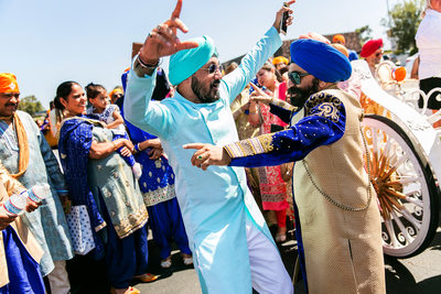 Sikh men dancing during Indian Baraat in San Diego