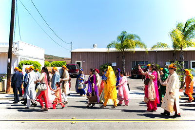 Colorful Baraat parade at San Diego Indian wedding