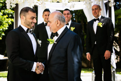 Candid groom with father and groomsmen photo in LA