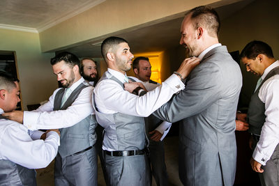 Groom and groomsmen getting ready for Cancun wedding