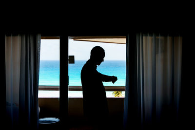 Groom silhouette portrait at Cancun beach wedding
