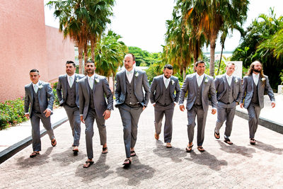 Groom and groomsmen walking through Omni Cancun Hotel