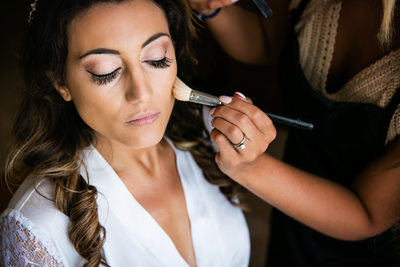Beautiful bride having makeup applied at Cancun wedding