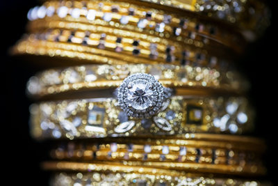 Details photo of wedding ring and Indian bangles