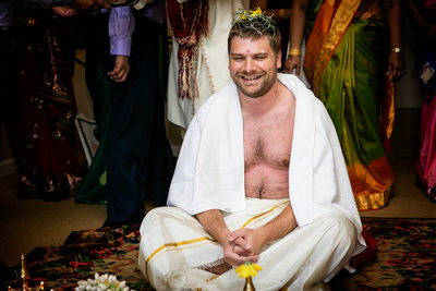 Candid photo of groom by Indian wedding photographer