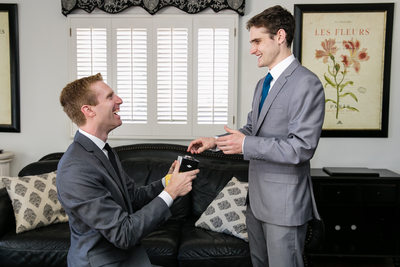 Groom giving gift to best man in Rolling Hills Estates