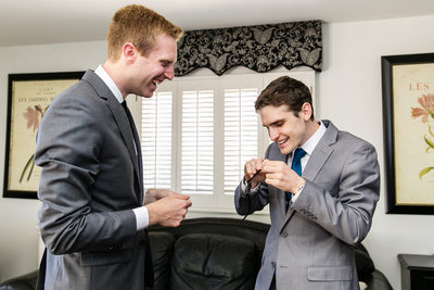 Best man opening gift with groom Rolling Hills Estates