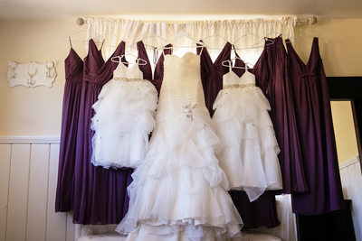 Bride, bridesmaids and flower girls' dresses hanging