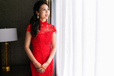 Bride wearing red qi pao for Chinese tea ceremony