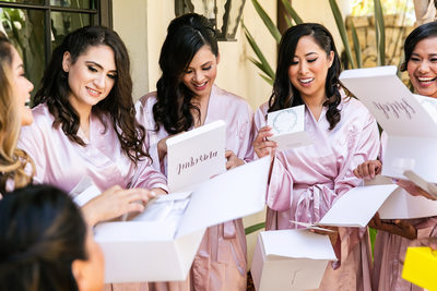 Bridesmaids opening gift boxes Trump National Golf Club