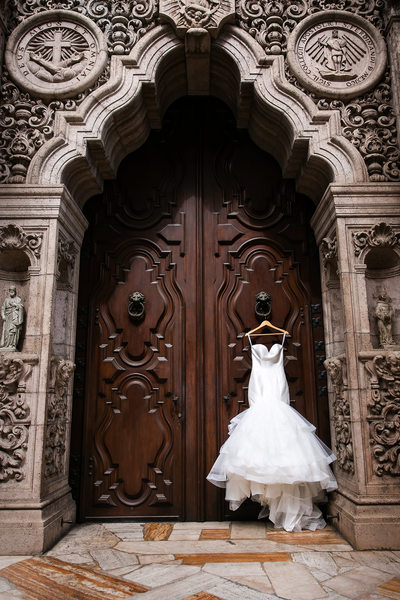 Wedding dress hanging outside the Mission Inn Chapel