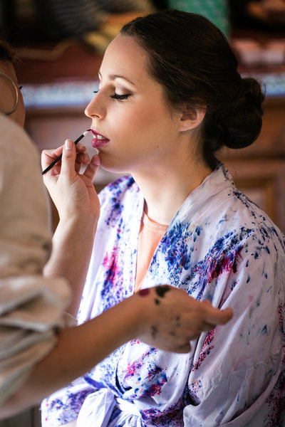 Bride getting ready photo with makeup artist