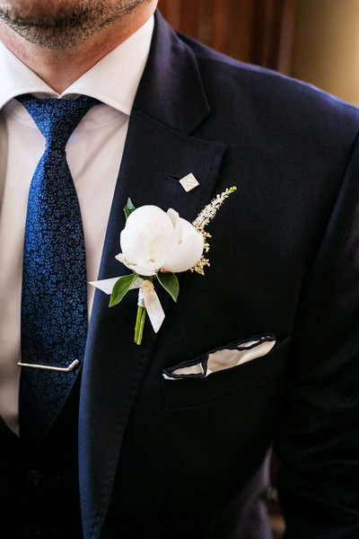 Close-up photo of groom's boutonniere LA photographer