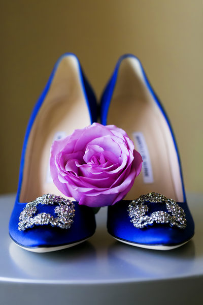 Blue wedding shoes with pink flower in Los Angeles