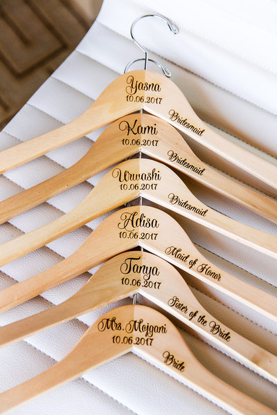 Wooden hangars with names at Hotel Irvine wedding