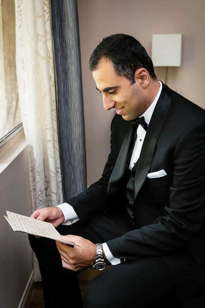 Groom reading note card at Glendale home