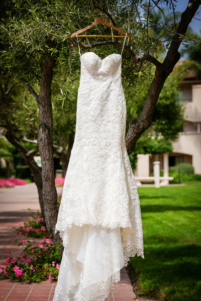 Wedding dress hanging in Santa Barbara gardens