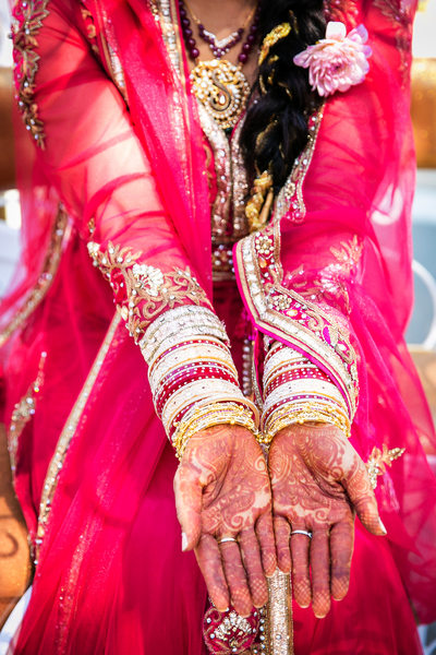 Details photo of bride's henna hands at Indian wedding
