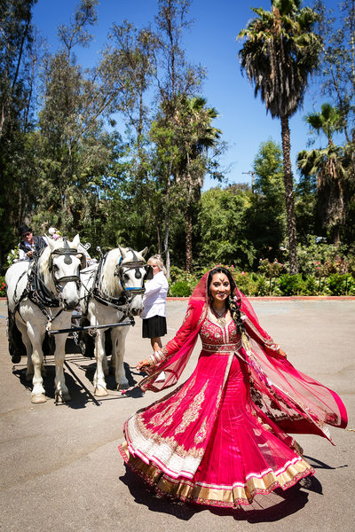 Indian bride leading horse carriage in San Diego