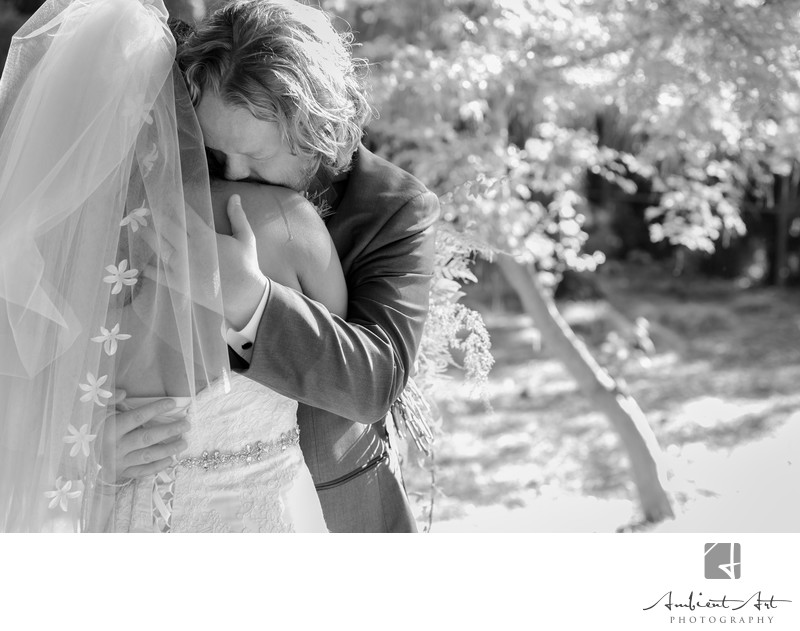 Groom crying on the brides shoulder at Woodward Park, Fresno