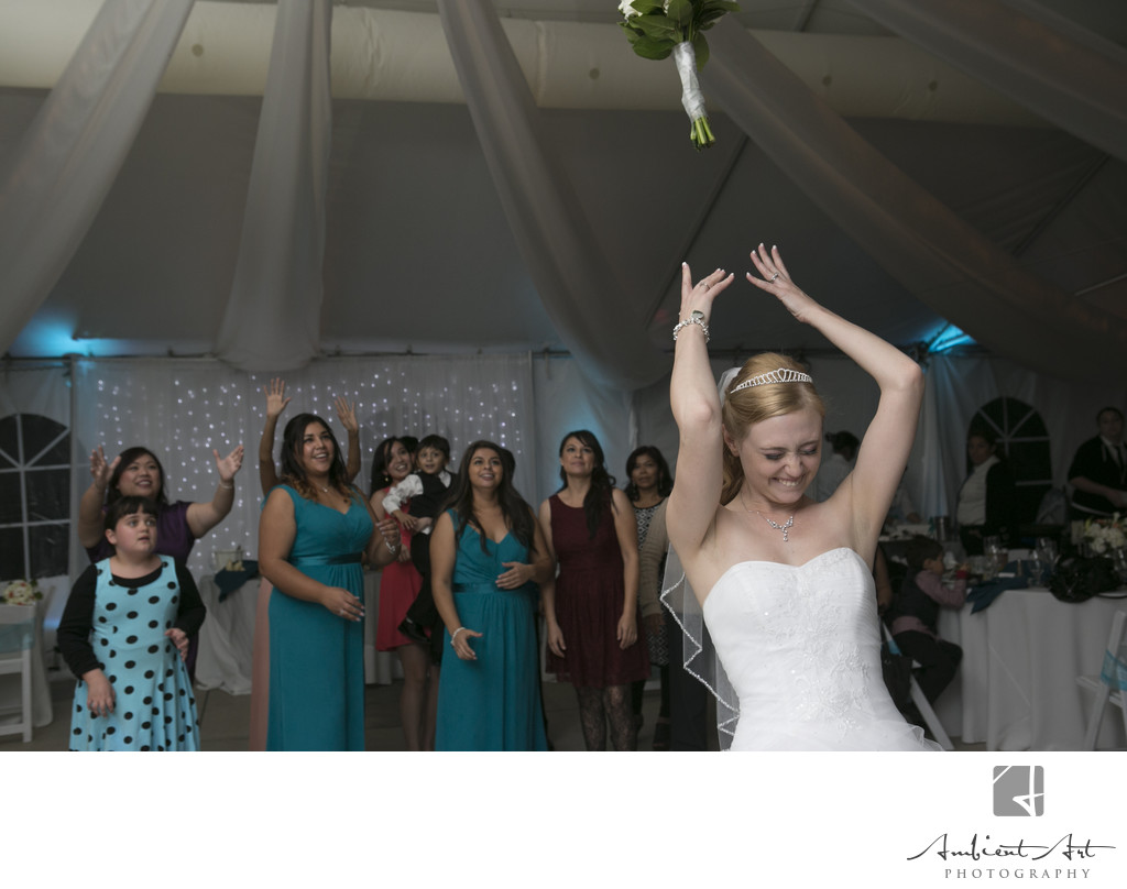 Bride throwing her bouquet.  Dinuba Wedding