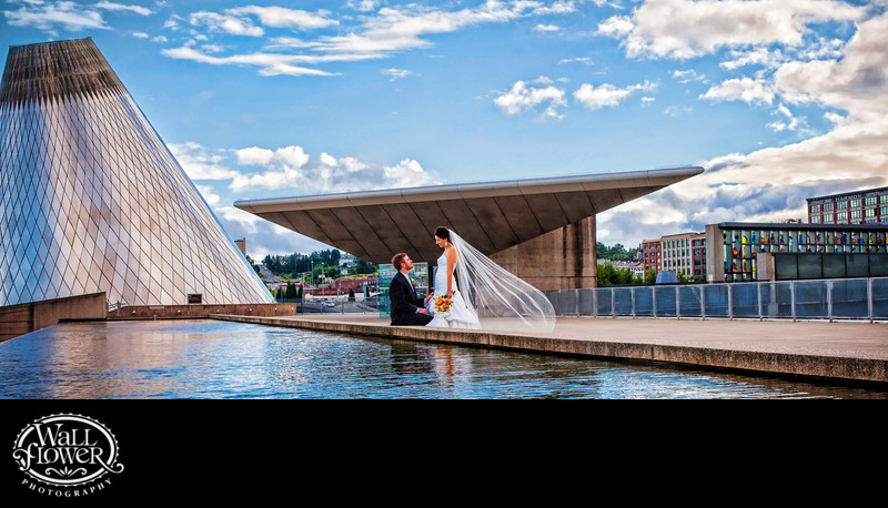 Bride and groom by reflecting pool at Museum of Glass — panorama crop