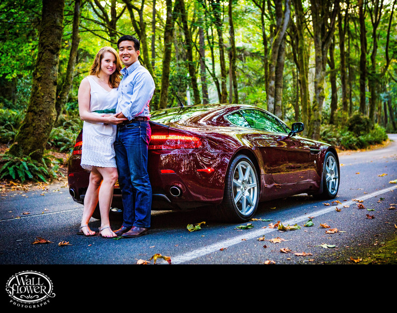 Engagement portrait by Aston Martin on forest road