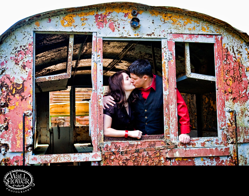 Engagement portrait in rusty train car