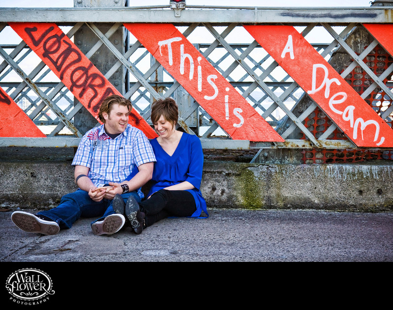 Engagement portrait by This is a Dream graffiti