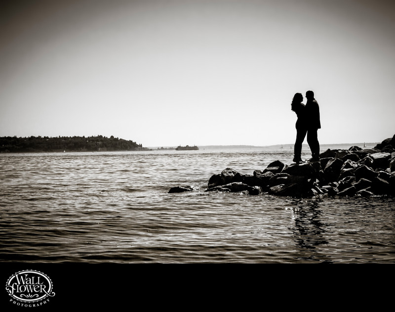 Engagement portrait silhouette by ocean in Seattle