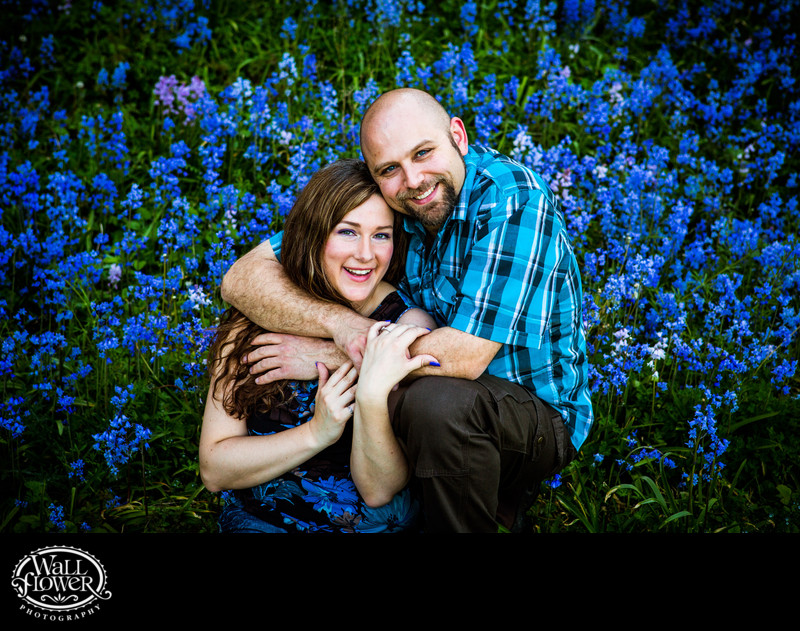 Engagement portrait hug in bluebell patch